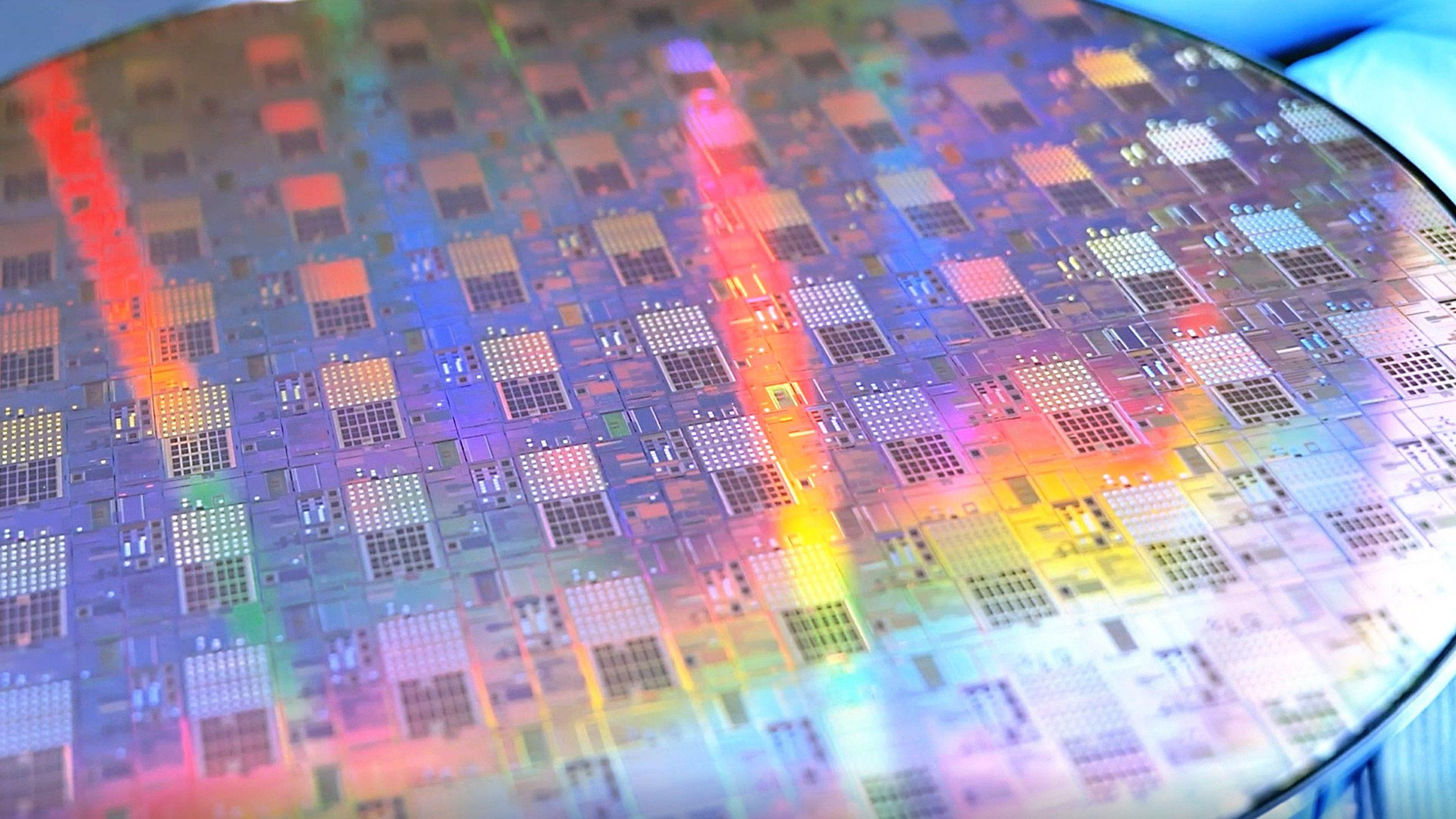 A new chip packaging tech & a first in analog compute