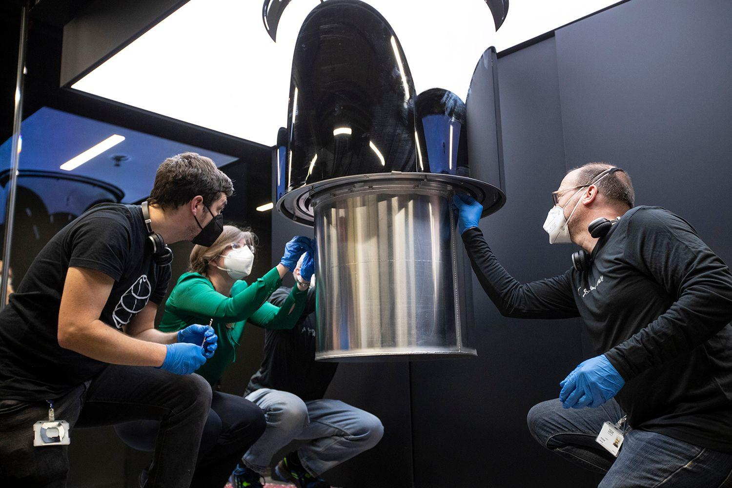 IBM Germany engineers working on the IBM Quantum System One.