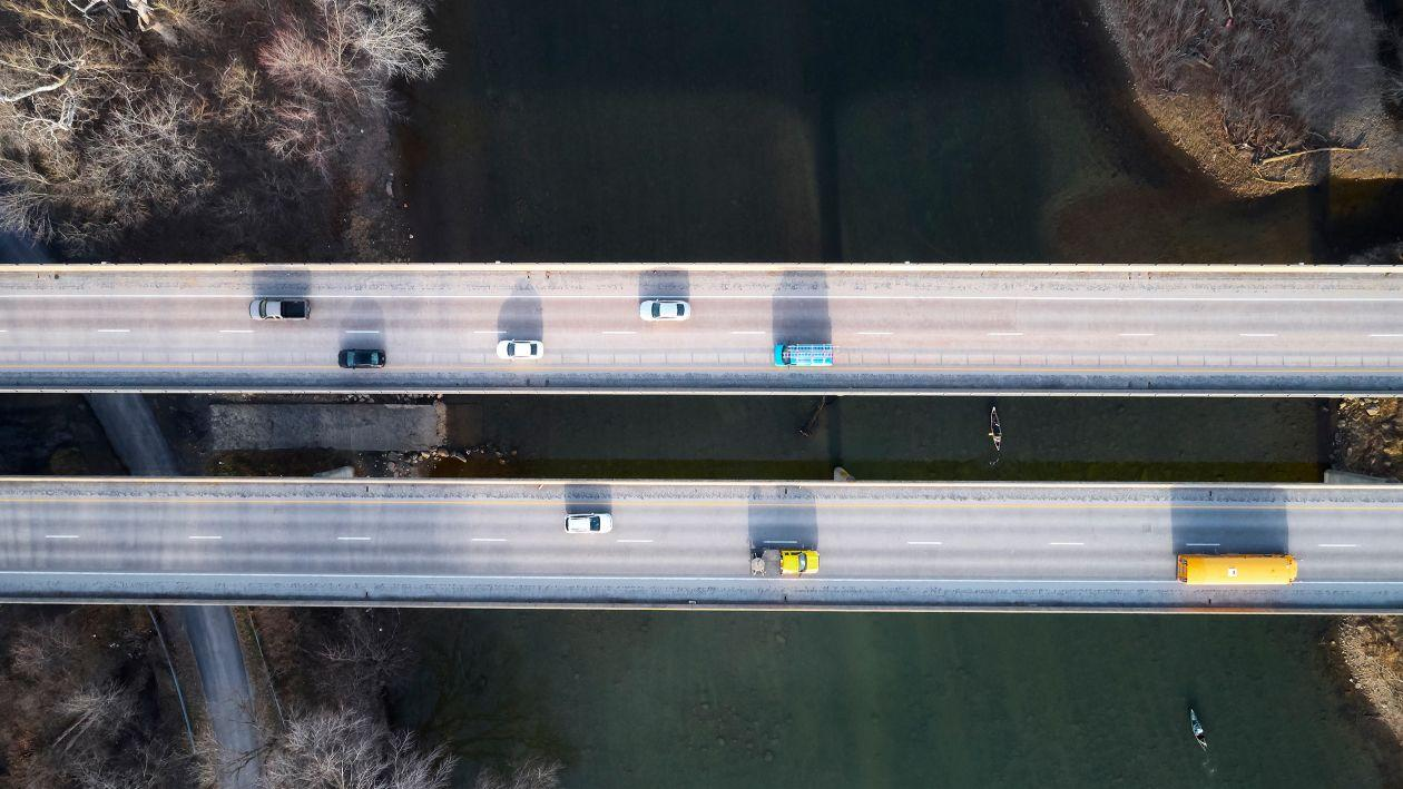 aerial photograph of a bridge with cars on it