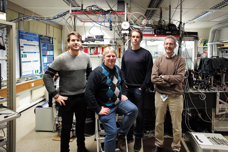 The IBM Research Europe team that developed the optical transistor (from left to right): Fabio Scafirimuto, Thilo Stöferle, Darius Urbonas, and Rainer Mahr